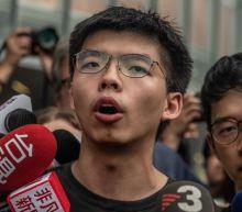 Hong Kong: Joshua Wong jailed over banned Tiananmen vigil