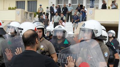 Raw: Shipyard workers, police clash in Greece