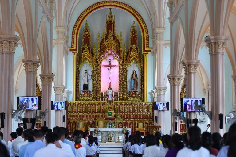 Residents attend Sunday mass at Phu Xuan village and pray for the missing (AFP Photo/NHAC NGUYEN)