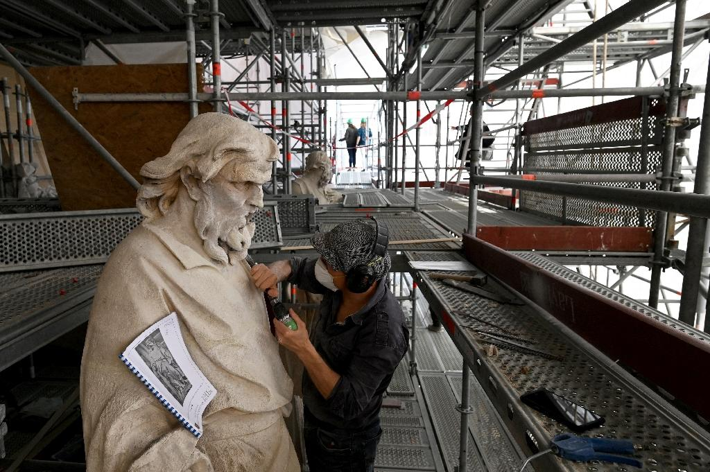 The restoration includes the roof timbers, the roof and decorative lead work, the statues and stained glass windows. (AFP Photo/Dominique FAGET)