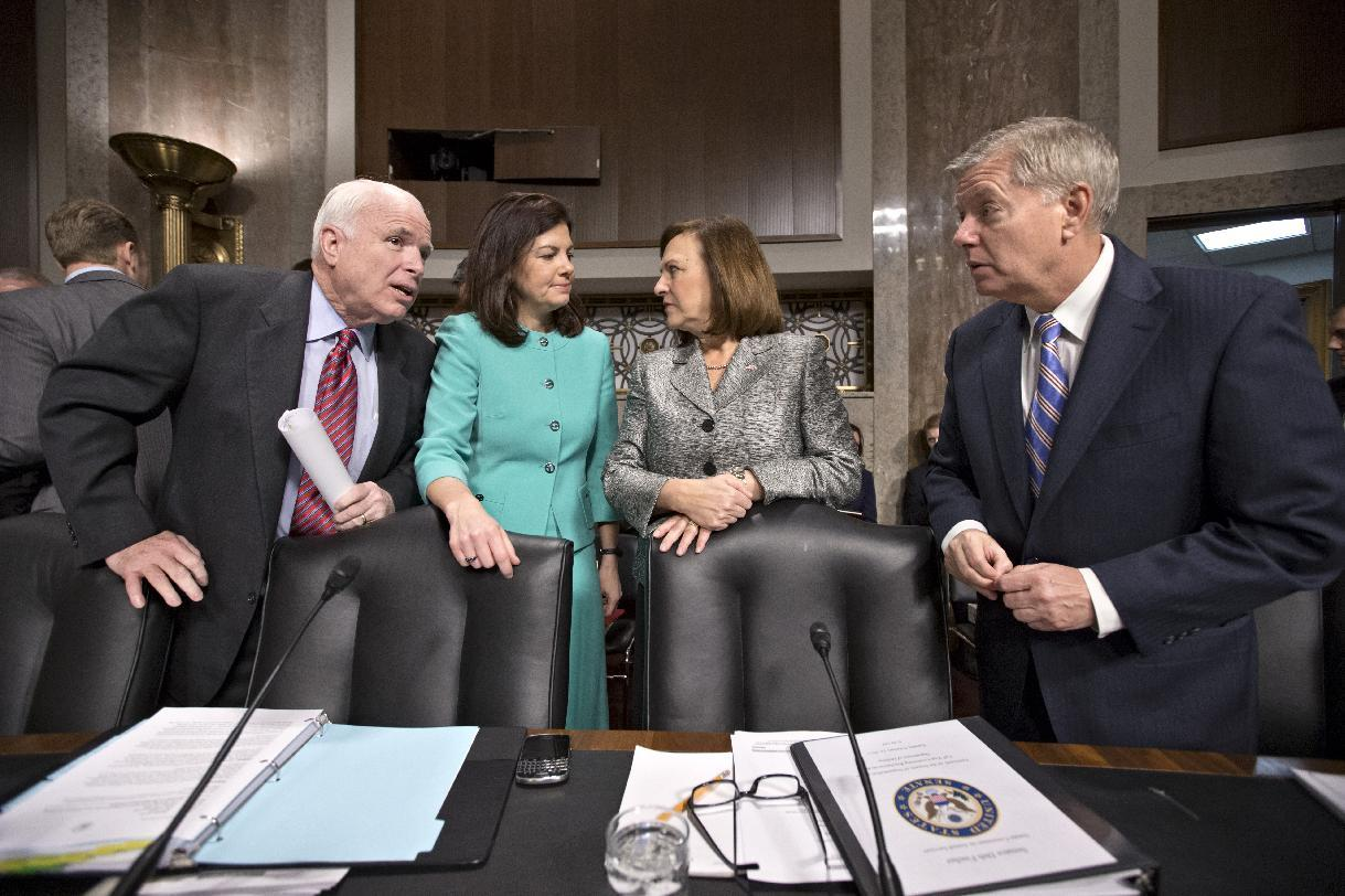 FILE – In this Feb. 12, 2013 file photo Senate Armed Services Committee members, from left, Sen. John McCain, R-Ariz., Sen. Kelly Ayotte, R-N.H., Sen. Deb Fischer, R-Neb., and Sen. Lindsey Graham, R-S.C., gather for a Capitol Hill hearing on looming defense budget cuts to be followed by a confirmation hearing on former Nebraska Sen. Chuck Hagel's nomination to Secretary of Defense. The fierce Republican opposition to the Hagel nomination has long been seen as a proxy for the never-ending scuffles between the Democratic president and congressional Republicans, with barely any reservoir of good will. Barring any surprises, the drawn-out battle will probably end this coming week with Hagel's Senate confirmation; but his fellow Republicans have roughed him up. (AP Photo/J. Scott Applewhite, File)