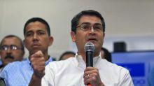 Honduras president keeps lead in disputed vote after recount