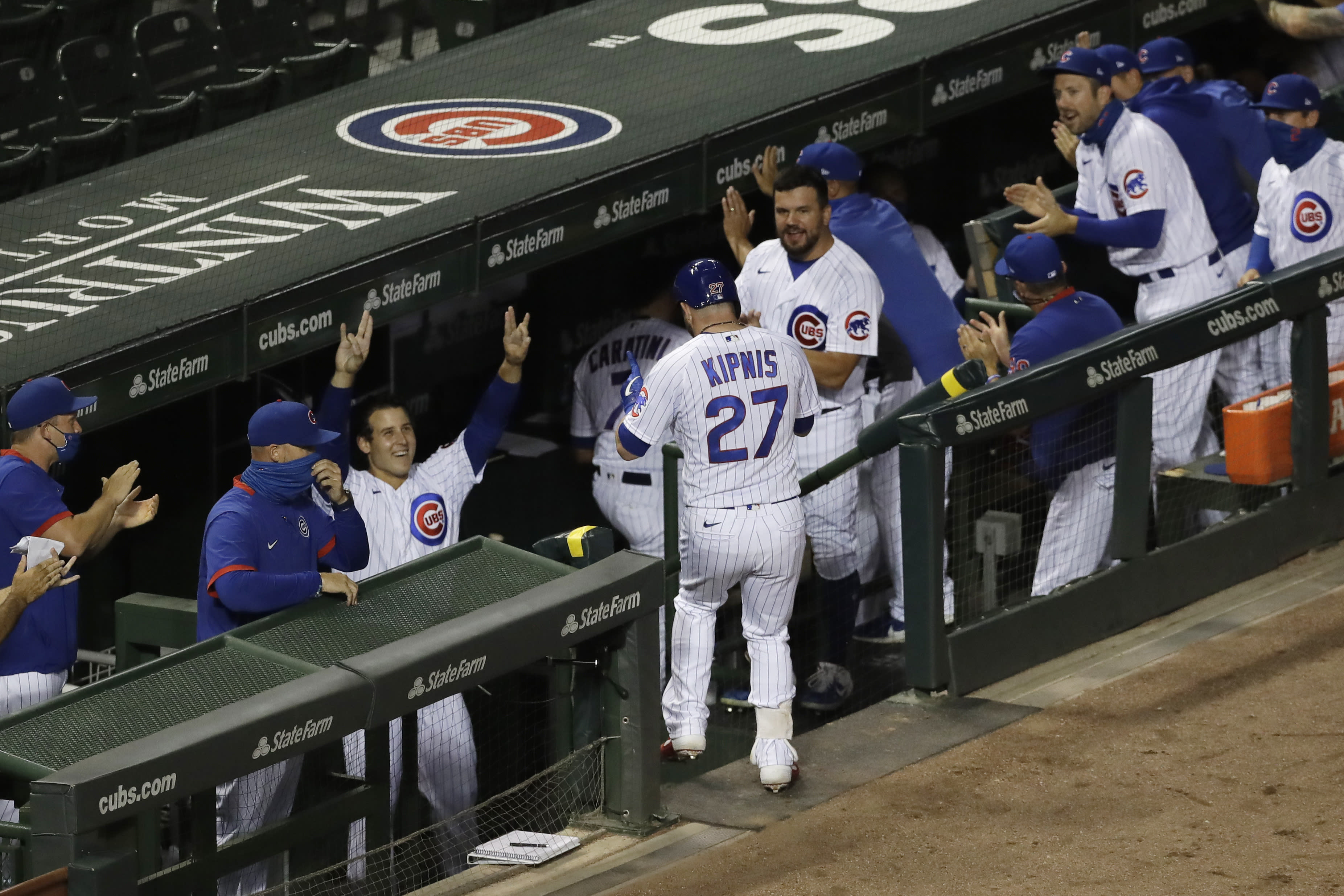 Chicago Cubs' Jason Kipnis (27) is congratulated by teammates after hitting a solo home run against the Pittsburgh Pirates during the fourth inning of a baseball game in Chicago, Friday, July 31, 2020. (AP Photo/Nam Y. Huh)