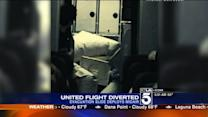 United Airlines Flight Bound For Orange County Diverted After Slide Deploys Inside Plane