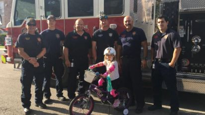 Girl whose family couldn't afford a bike gets surprise gift from paramedics