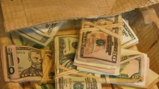 Pile of Cash is Really Carved Wood