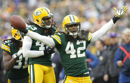 577f7cf55 FILE PHOTO: Green Bay Packers' Burnett reacts after getting  interception against Minnesota