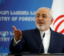 Iran parliament clears oil, foreign ministers for Rouhani's new cabinet