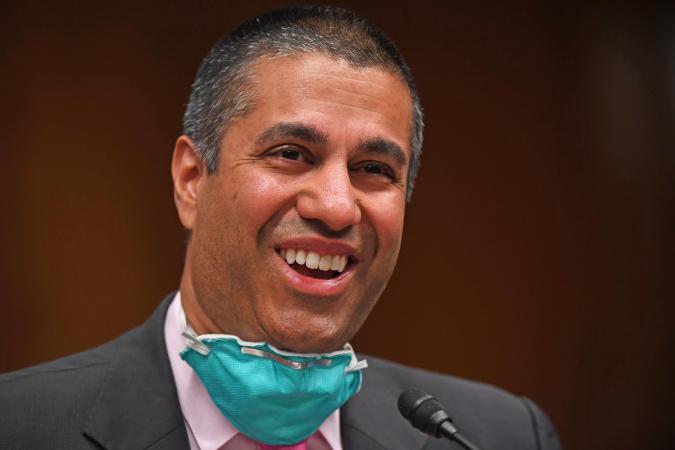 Ajit Pai, the FCC head, seen laughing.