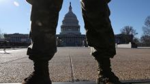 U.S. Capitol calm amid high security; Trump supporters hold faith he will return