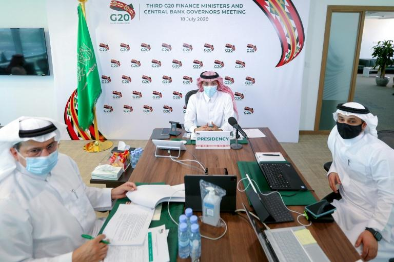 Saudi Finance Minister Mohammed al-Jadaan (C) chairs a virtual meeting of finance ministers and central bank governors from G20 nations, in the capital Riyadh