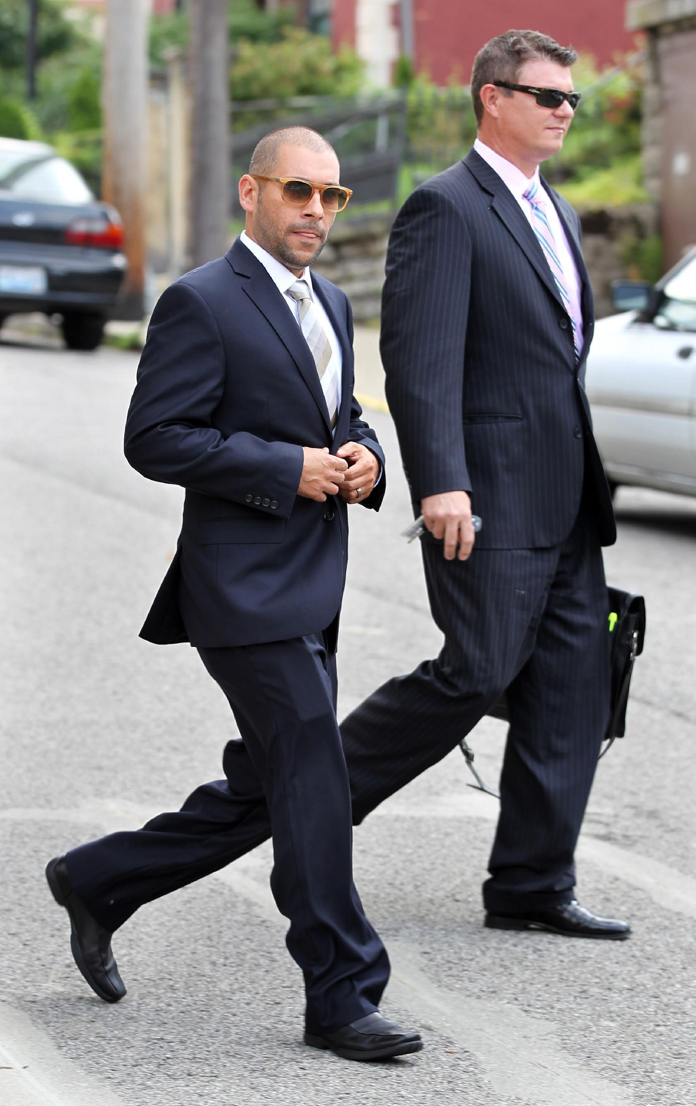 FILE - This photo made July 11, 2013, shows Nik Richie, left, owner of the gossip website TheDirty.com, leaving the Federal Courthouse in Covington, Ky., with his lawyer, David Gingra, after a jury awarded Sarah Jones $338,000 in her defamation lawsuit against the website. (AP Photo/Cincinnati Enquirer, Patrick Reddy) NO SALES