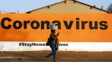 South African health system under strain as coronavirus cases surge