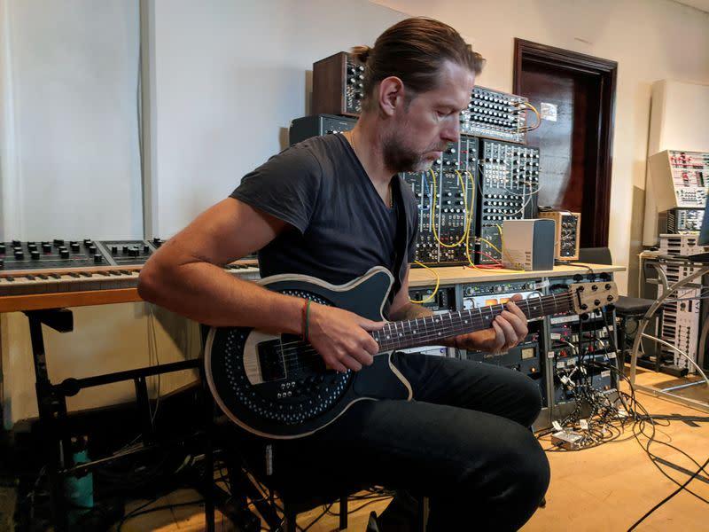 Radiohead strummer tests radical redesign of electric guitar