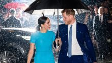 Prince Harry and Meghan Markle have a film star moment in the rain at Endeavour Awards