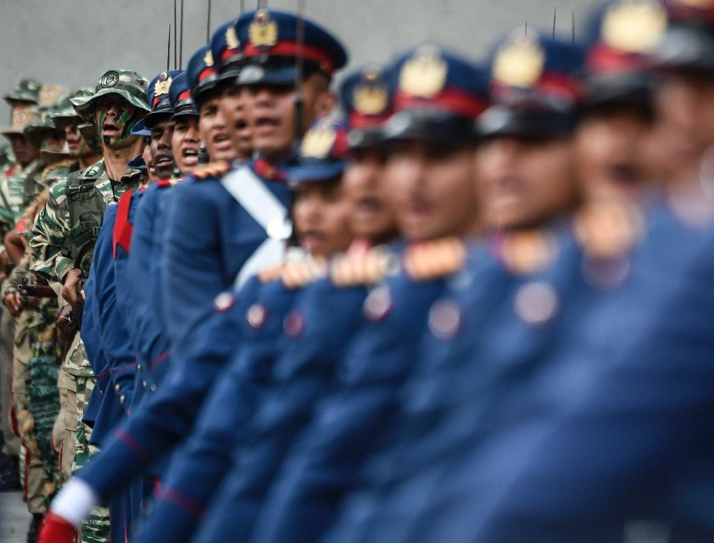 Venezuelan soldiers march during a military ceremony to honor President Nicolas Maduro on May 24, 2018