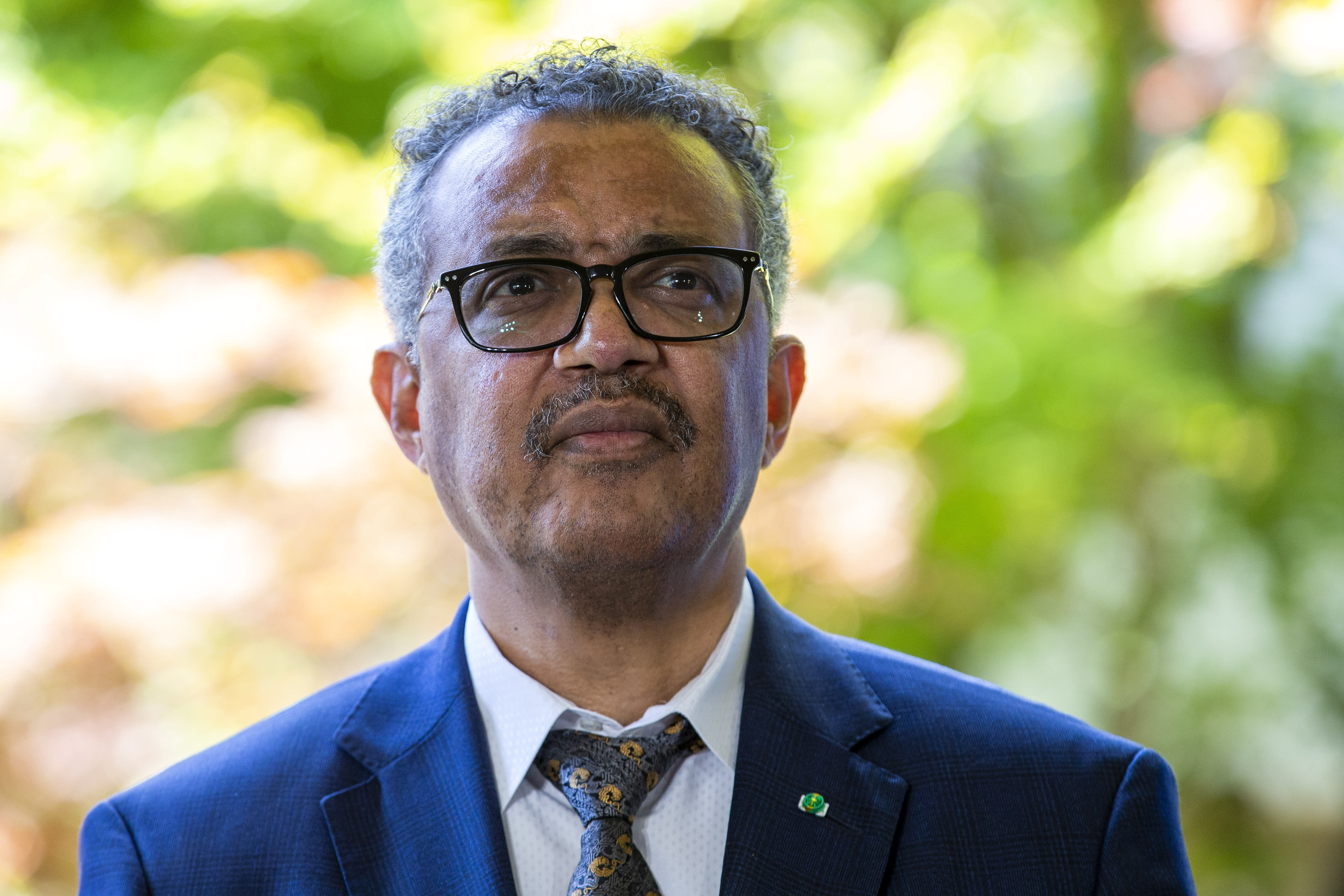 """FILE - In this Thursday, June 25, 2020 file photo, Tedros Adhanom Ghebreyesus, Director General of the World Health Organization (WHO), attends a press conference, at the (WHO) headquarters in Geneva, Switzerland. The World Health Organization chief on Monday, July 13 slammed government leaders whose mixed messages have eroded public trust on the coroanvirus. Tedros Adhanom Ghebreyesus warned that their failures to stop their countries' spiraling outbreaks means there's no return to normal """"for the foreseeable future."""" (Salvatore Di Nolfi/Keystone via AP, File)"""