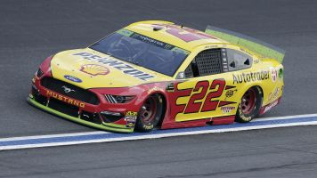 Logano's car goes to garage before race begins
