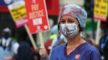 NHS staff smear themselves in fake blood in Downing Street protest over pay