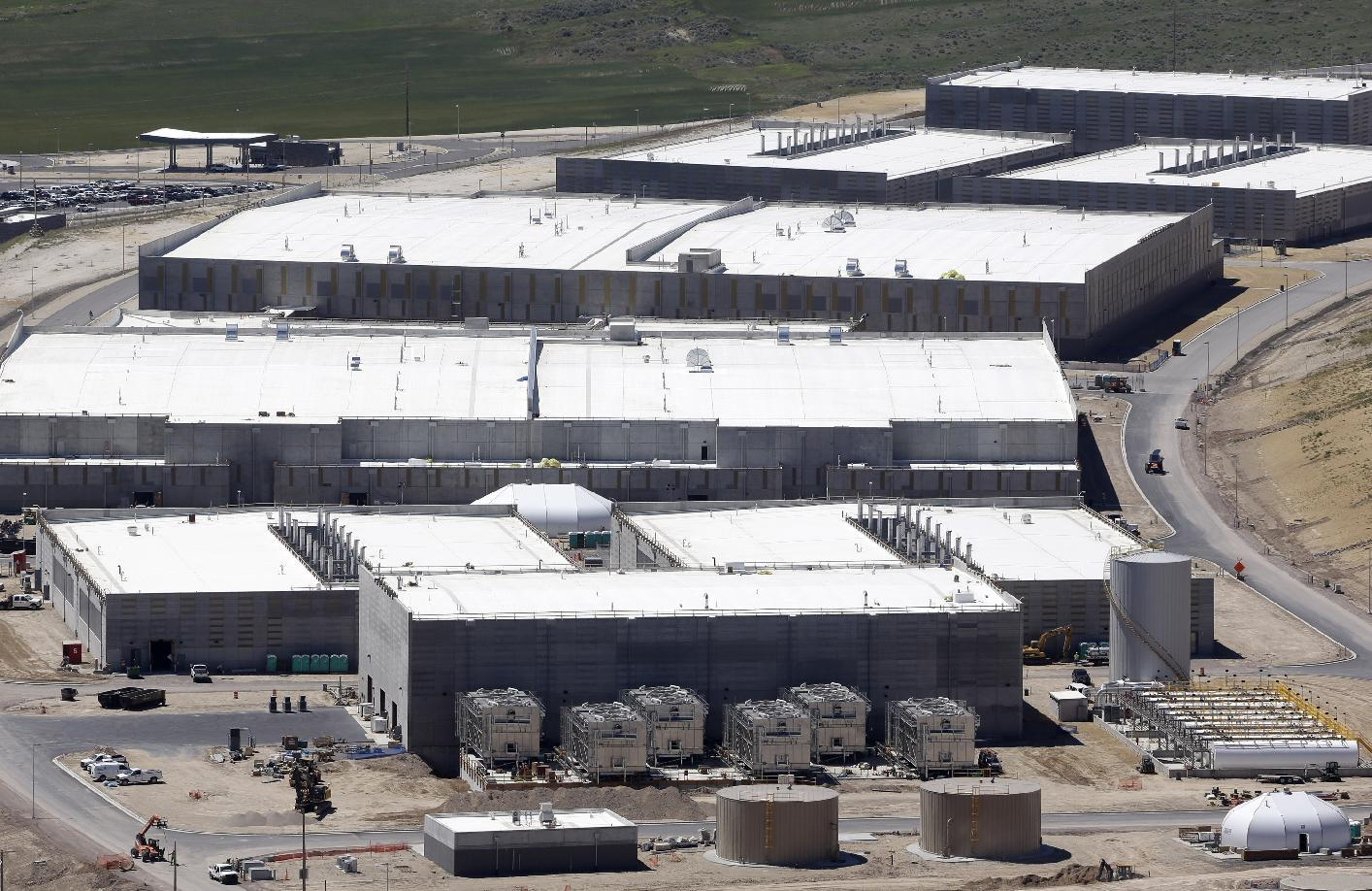 FILE - NSA's Utah Data Center is shown in this Thursday, June 6, 2013 file photo taken in Bluffdale, Utah. Newly declassified documents released Tuesday Sept. 10, 2013 tell a story of a surveillance apparatus so unwieldy and complex that nobody fully comprehended it, even as the government pointed it at the American people in the name of protecting them. Documents from the Foreign Intelligence Surveillance Court show that even senior lawyers and officials weren't sure how the system worked and didn't understand what they were told. (AP Photo/Rick Bowmer, FILE)