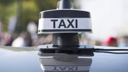 Quebec announces plan to compensate taxi drivers after Uber's arrival