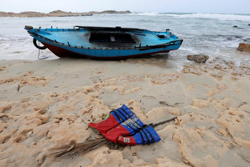 FILE PHOTO: A boat used by migrants is seen near the western town of Sabratha