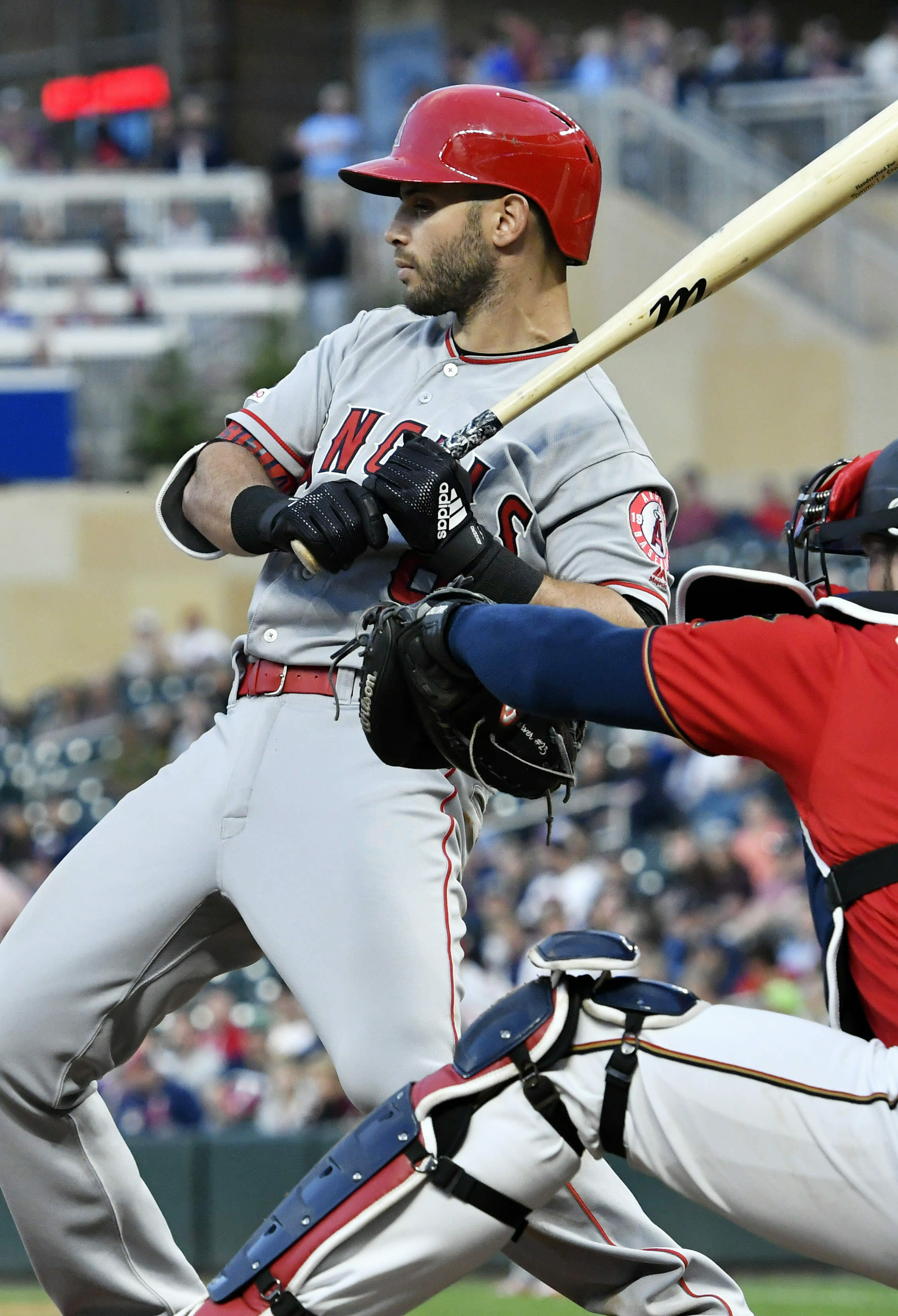 Los Angeles Angels' Justin Upton rears back from a close pitch by Minnesota Twins pitcher Kyle Gibson in the sixth inning of a baseball game Tuesday, May 14, 2019, in Minneapolis. (AP Photo/Jim Mone)