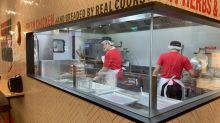 KFC Singapore launches its first open-kitchen restaurant, to reveal how its chicken is prepared through public tours