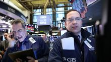 Wall Street closes slightly higher, industrials lead
