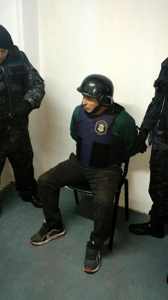 An Argentinian police photo of former secretary of public works Jose Lopez in detention in Buenos Aires on June 15, 2016 (AFP Photo/)