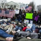 Students stage White House protest as Trump gives nod to background bill