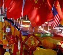 """The Latest: Trump """" says developments in US-China trade"""