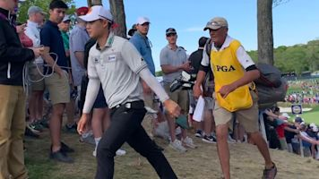 Grocery worker caddying for PGA contender