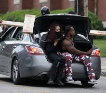 The Latest: Protesters outside Louisville church amid curfew