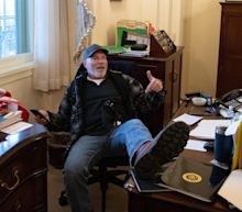 The Capitol riot suspect pictured with his feet on a desk in Pelosi's office had a tantrum in court, yelling 'it's not fair' that he's been jailed