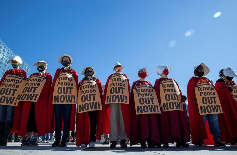 """Some protesters came to the march in Washington dressed as characters from the dystopian novel and television series """"The Handmaid's Tale,"""" who are forced to bear children"""