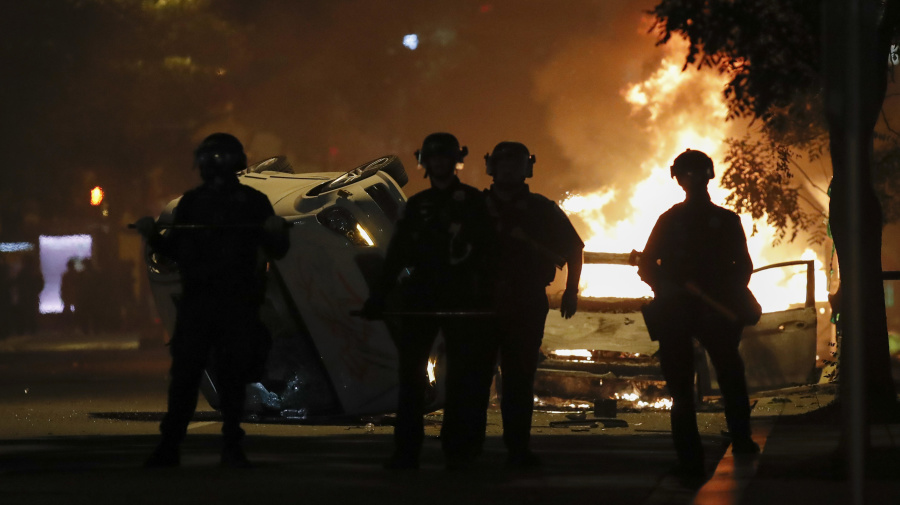 Unrest overshadows peaceful U.S. protests for another night