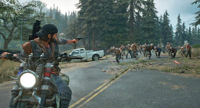 A still from the video game Days Gone showing a man on a motorcycle shooting backwards at zombies.