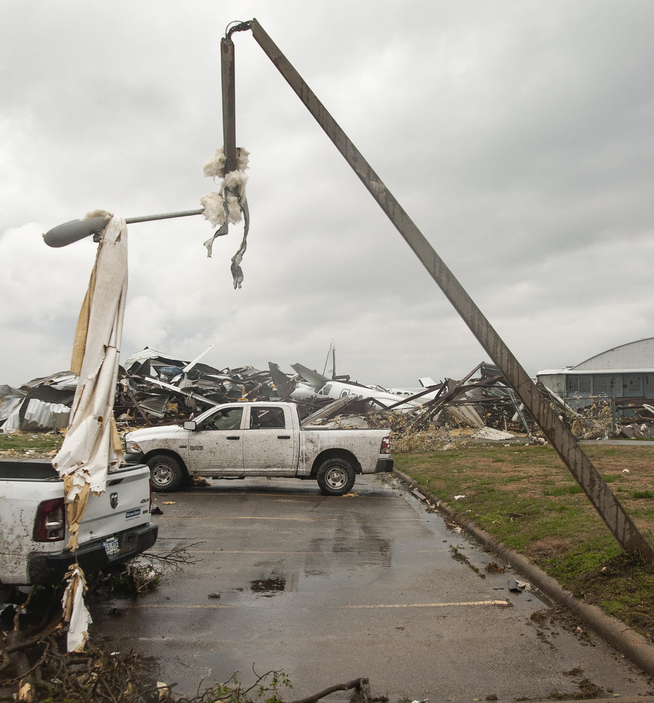 A light pole is damaged and draped with debris after a tornado Saturday, March 28, 2020, at Jonesboro Municipal Airport in Jonesboro, Ark. (Quentin Winstine/The Jonesboro Sun via AP)