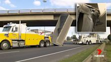 Amazing footage shows moment truck slams into busy overpass