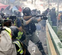 AP Photos: Hong Kong police battle protesters on campus