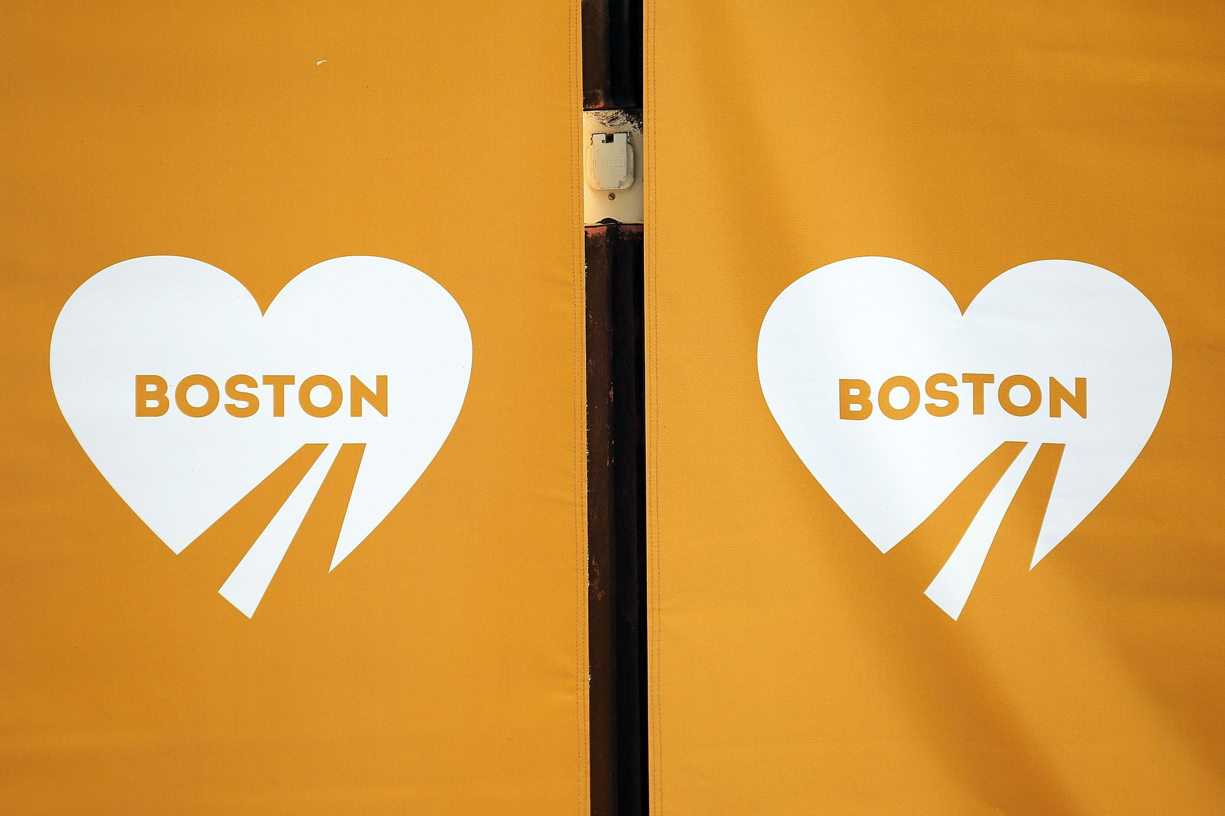 BOSTON, MA - APRIL 15:  A detailed view of orange banners on Boylston Street commemorating the two-year anniversary of the 2013 Boston Marathon bombings, on April 15, 2015 in Boston, Massachusetts. Two years ago, two pressure cooker bombs killed three and injured an estimated 264 others during the Boston marathon on April 15, 2013.  (Photo by Tim Bradbury/Getty Images)
