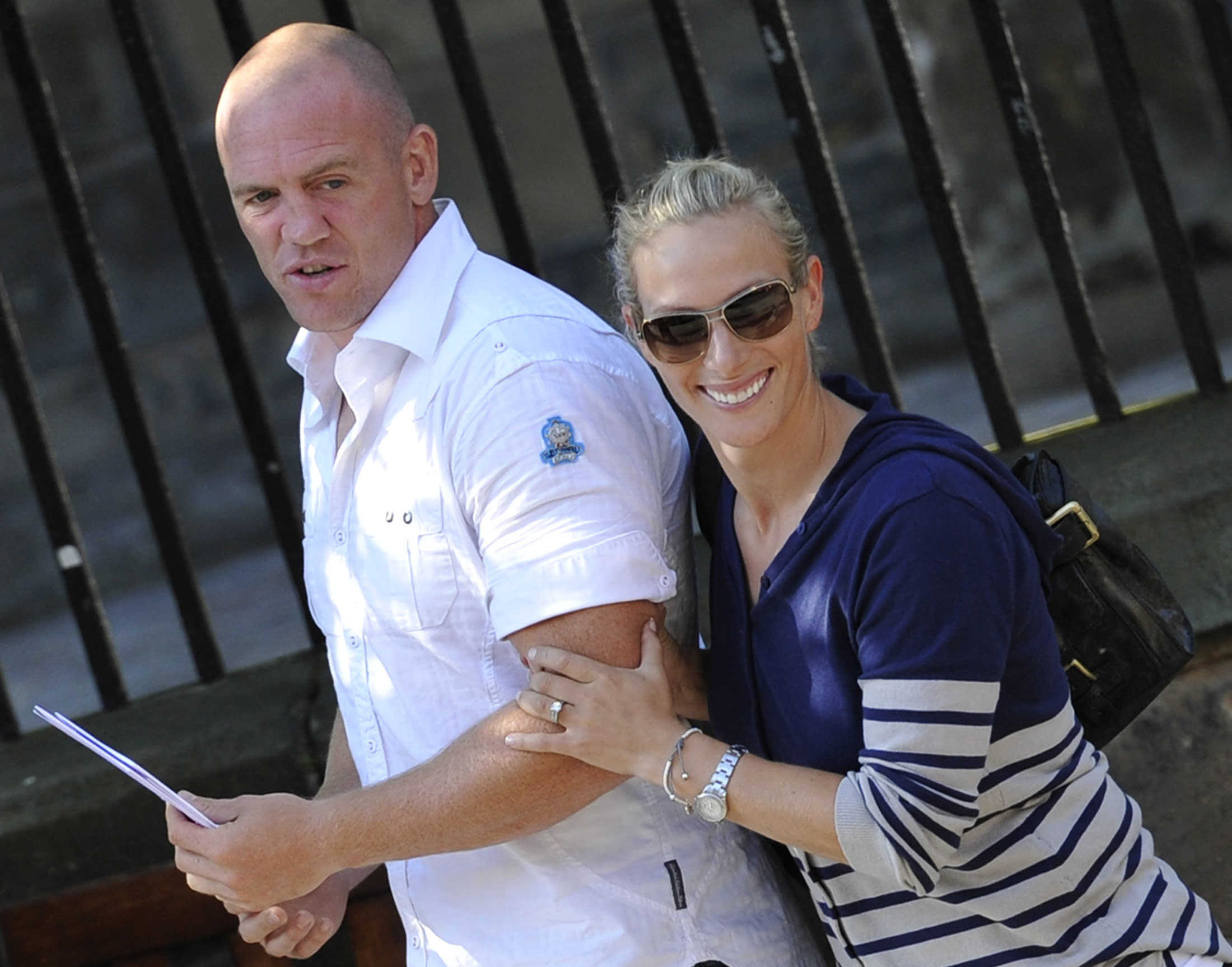 Britain's Zara Phillips, the eldest granddaughter of Queen Elizabeth, and England rugby captain Mike Tindall leave after their wedding rehearsal at Canongate Kirk in Edinburgh, Scotland July 29, 2011.    REUTERS/Dylan Martinez   (BRITAIN - Tags: ENTERTAINMENT SOCIETY ROYALS SPORT)
