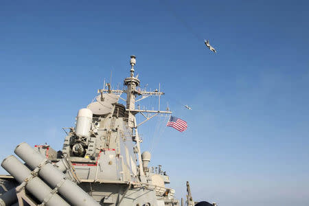 An U.S. Navy picture shows what appears to be a Russian Sukhoi SU-24 attack aircraft flying over the U.S. guided missile destroyer USS Donald Cook in the Baltic Sea