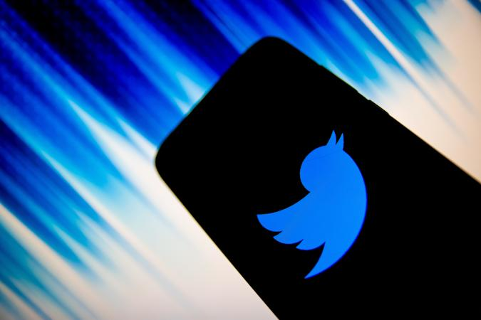 In this photo illustration Twitter logo is displayed on a smartphone screen in Athens, Greece on December 14, 2020. (Photo by Nikolas Kokovlis/NurPhoto via Getty Images)