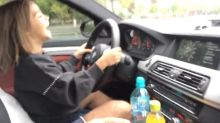Young girl takes control of her dad's BMW M5 in car park