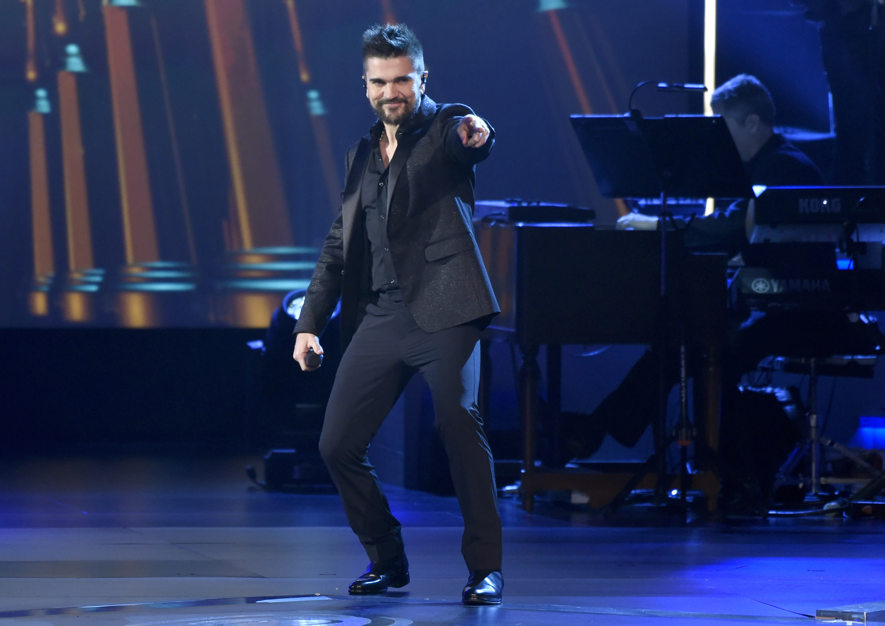 "FILE - Juanes performs ""Quisiera Ser"" at the Latin Recording Academy Person of the Year tribute honoring Alejandro Sanz on Nov. 15, 2017, in Las Vegas. Juanes turns 48 on Aug. 9. (Photo by Chris Pizzello/Invision/AP, File)"