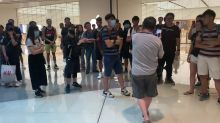 Row erupts outside Hong Kong Apple Store between protesters and resident