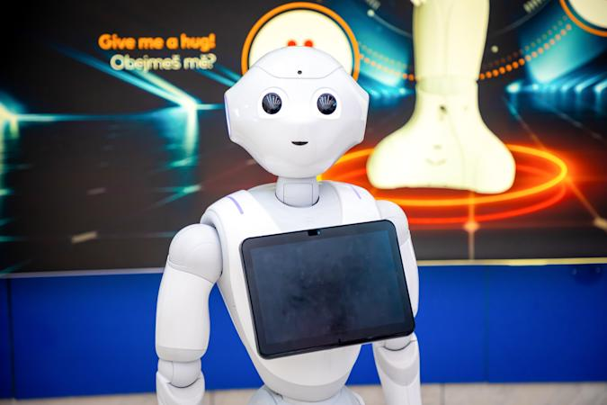 Prague, Czech republic - February 1, 2019: The Robot consultant with digital tablet in Prague airport in Czech republic. The robot is making multi-lingual announcement