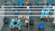 Wary Hong Kongers shun China-backed mass virus testing